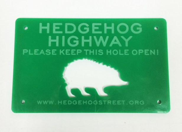 Green label with hedgehog picture stating 'Hedgehog Highway'
