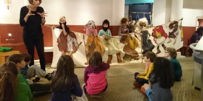 Image of children holding up cloth painting of stone-age-timeline