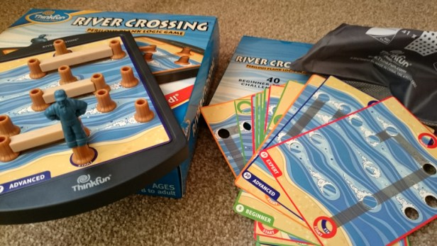 river-crossing-game-displayed-to-show-cards-and-3d-logs-and-explorer-pieces