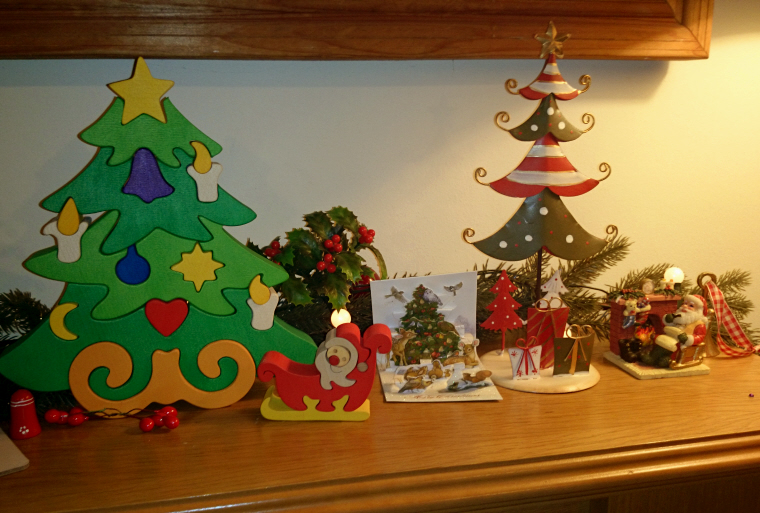 Image of wooden decorations-on-a-fireplace shelf