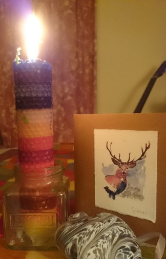 Image of multicoloured-stripey-candle-with-stag-greetings-card-and-glass-heart-display