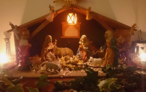 Image of nativiy-crib-with-candles-ivy-animals-and-figurines