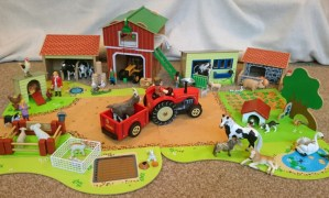 Image of wooden-farmyard-set-up-with-tractor-and-animals