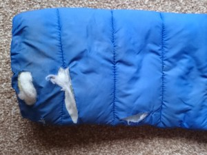 Image of sleeve-of-blue-coat-with-slashes-showing-white-padding-inside