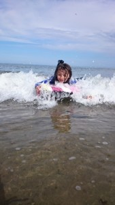 Image of girl on bodyboard with white water in sea