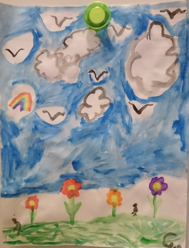 Child's watercolour picture of flowers, clouds and blue sky