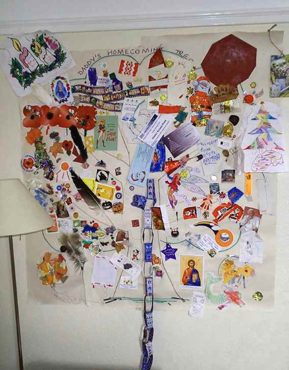 Hand drawn tree on wall covered with bric a brac decorations