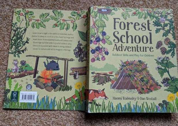 Image of forest school adventure book front and back cover folded out on beige background
