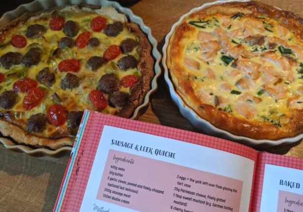 Imáge of two flan dishes with different quiche flavours in on top of recipe page from Jolly Good Food book stating sausage and leek quiche