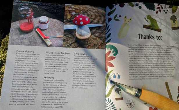 Image of double page spread of book showing painted wooden mushrooms with red caps and white spots