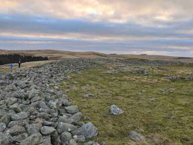 Image of stone wall outline of hillfort boundary on hilltop plateau