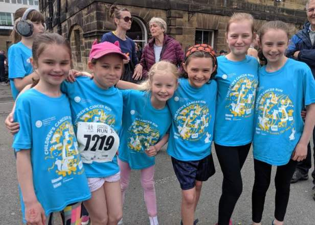 Image of 6 girls in blue Childrens Cancer Run T-shirts