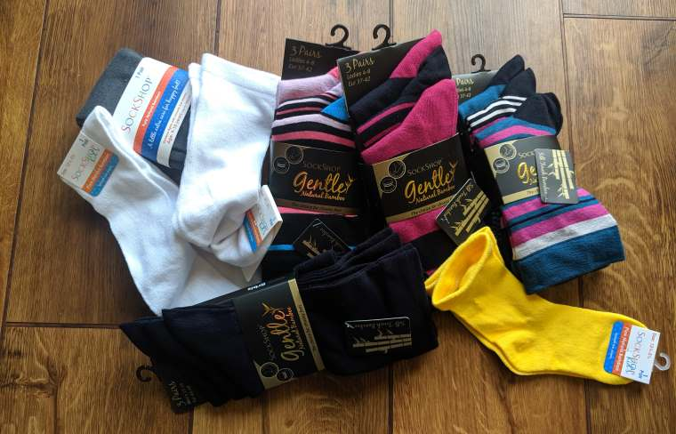 Image of multicoloured pairs of unopened bamboo socks and tights from SockShop