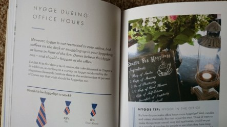 open-book-showing-page-with-photo-of-cafe-table
