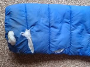 sleeve-of-blue-coat-with-slashes-showing-white-padding-inside