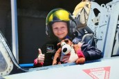 Girl in helmet in open cockpit