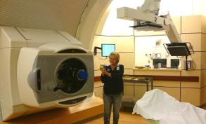 Woman in proton beam radiotherapy room