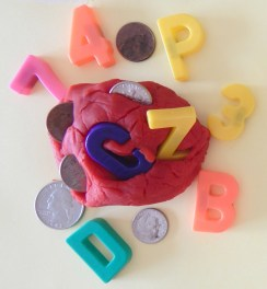 Playdoh with letters, numbers, and coins hidden within it