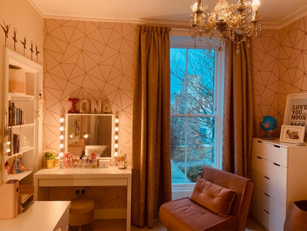 shot of window area with dressing table and cosy sofa bed seating area.