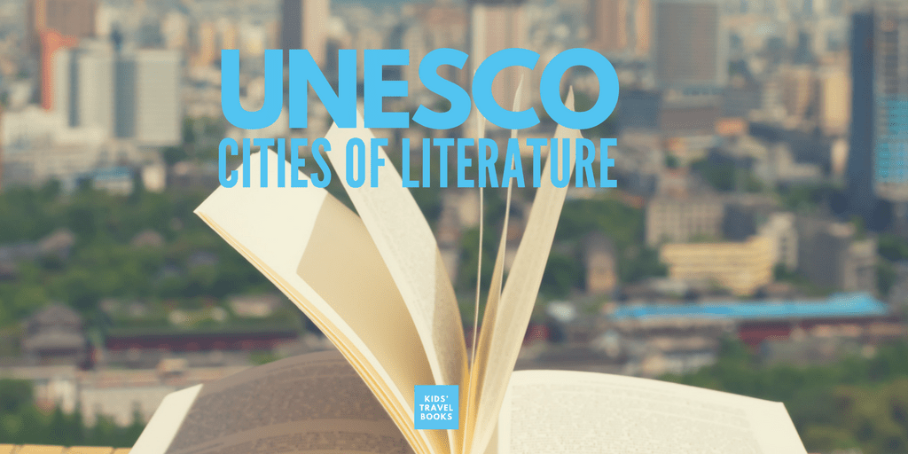 "Open book with a city behind it and the words ""UNESCO CITIES OF LITERATURE"""