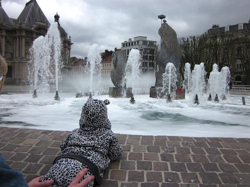 Baby Z admiring a fountain in Lille- Kid World Citizen