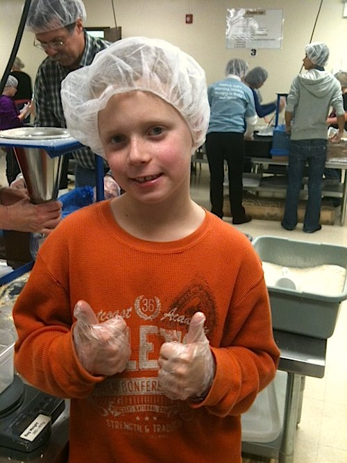 Kids Volunteering Feed My Starving Children- Kid World Citizen