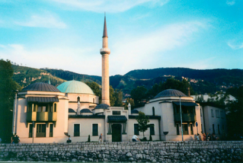 Pedestrians walk by the Emperor's Mosque built in the Ottoman era, the oldest mosque in Sarajevo, the capital and largest city of Bosnia and Herzegovina. CC Use: Asim Led