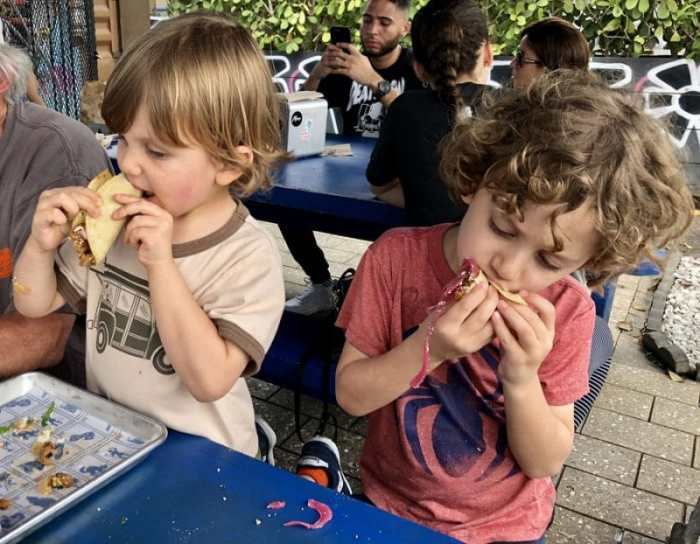 Kids eating tacos in Miami