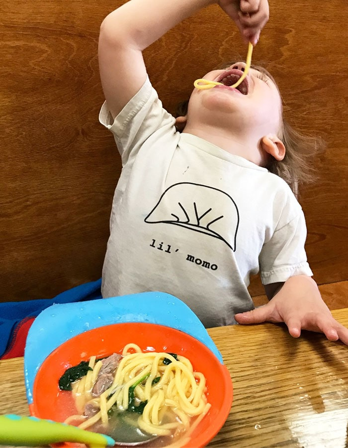 Toddler eating Malaysian food