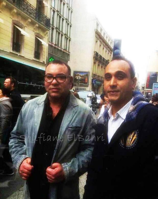 صور مع مهاجر مغربي.. الملك في باريس