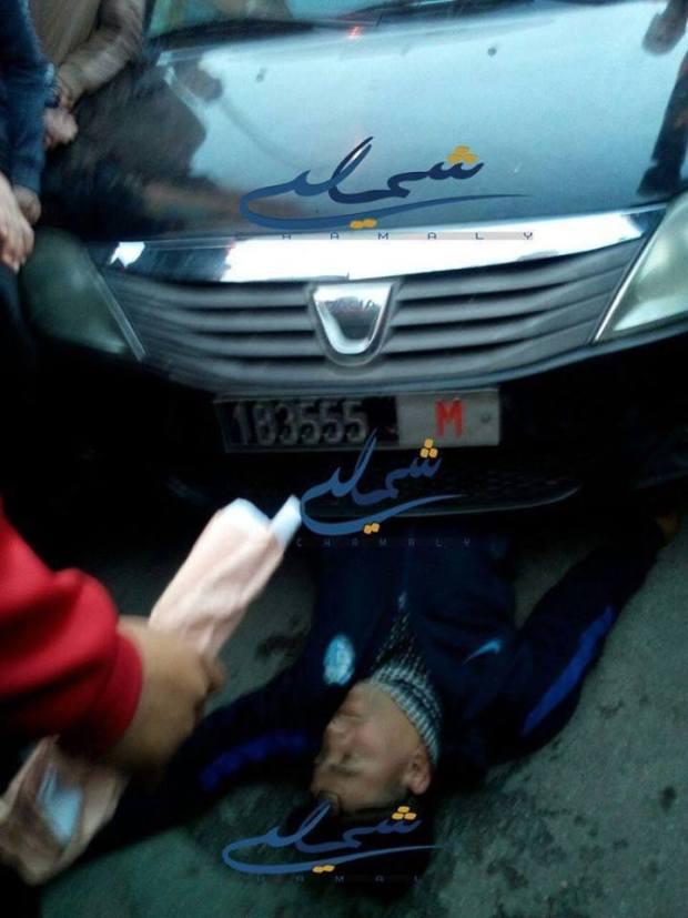 """بالفيديو والصور من طنجة.. رجل سلطة """"يدهس"""" محتجا!!"""