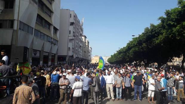 منيب مع العبادي والأعلام الوطنية تغيب مرة أخرى.. تناقضات في مسيرة الرباط!