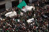 People carry their national flags as they gather during a protest over President Abdelaziz Bouteflika's decision to postpone elections and extend his fourth term in office, in Algiers, Algeria March 15, 2019. REUTERS/Zohra Bensemra - RC150EE6E030