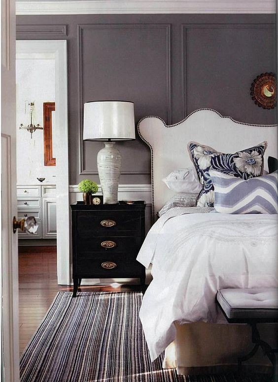 ... Pattern And Shades Of Purple And The Walls Are Painted In A Grey Purple  Tone As Well. The Purple Hue Is Balances Out With Neutrals Like White And  Black.