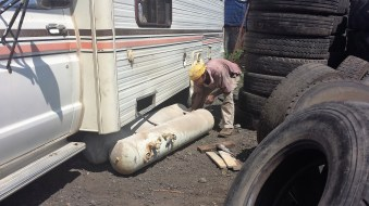 Eduardo is removing my obsolete propane tanks