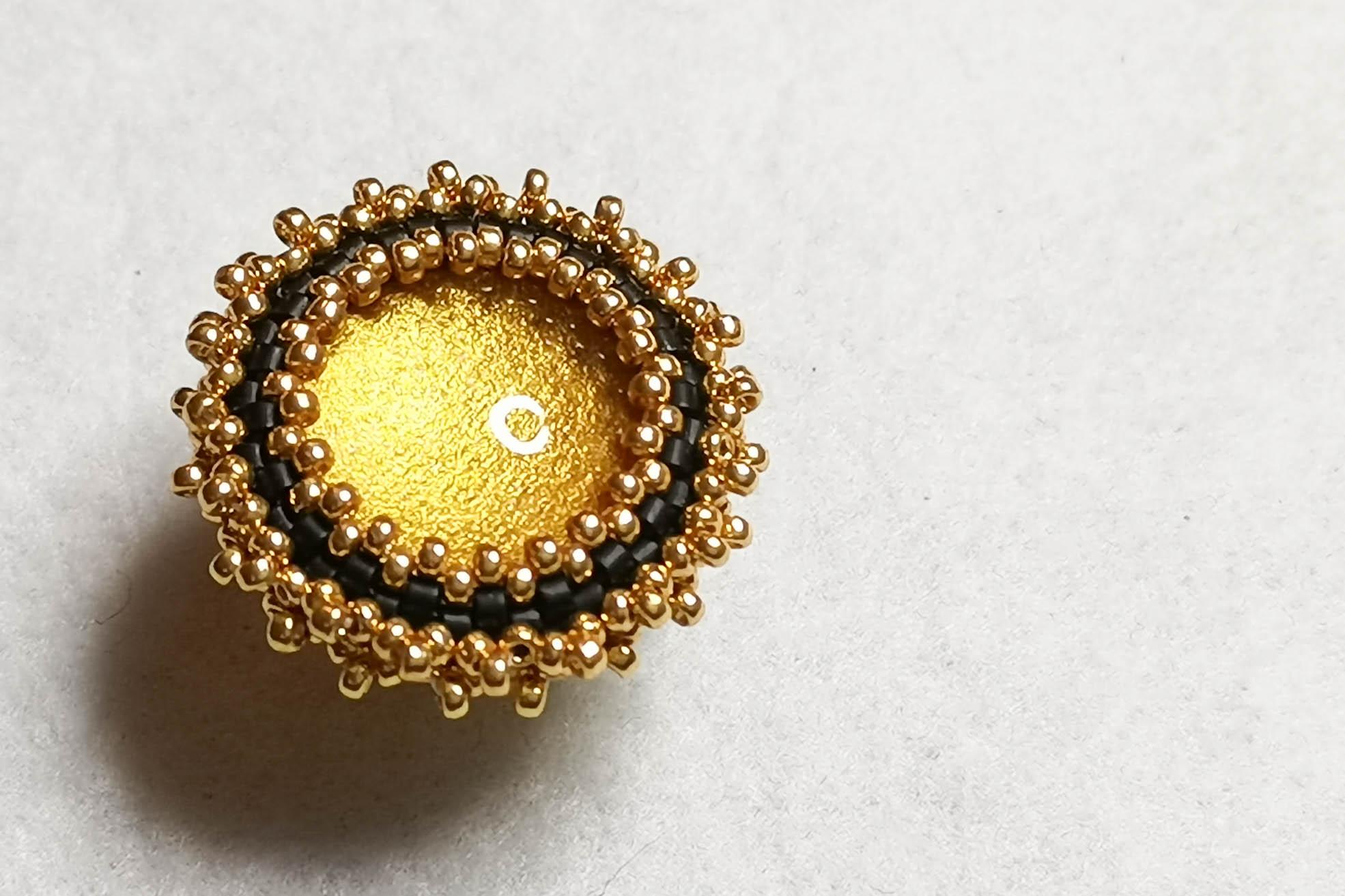gold-black-brooch