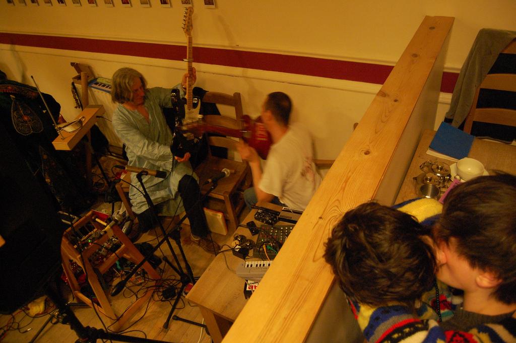 A couple canoodle while guitars collide!