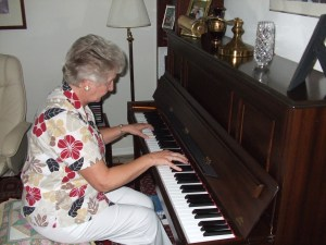 June at the piano