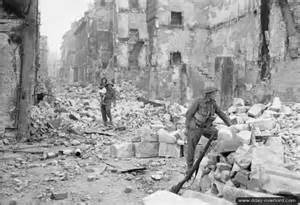 Soldiers among the rubble during the battle for Caen, 1944