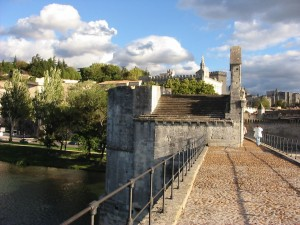 The historic bridge of Avignon with Papal palace in the background