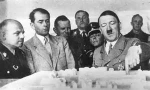 Hitler pointing at model