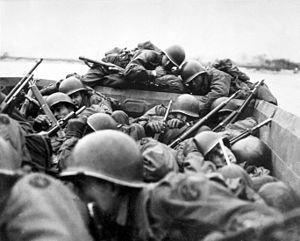 U.S. troops under fire crossing the Rhine