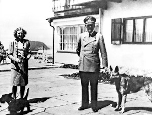 Hitler and Eva Braun on the terrace of the Berghof with their beloved dogs.