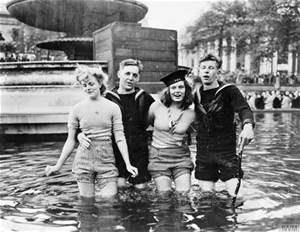 Dancing in the Trafalgar Square fountains - V.E. Day