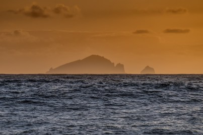 St Kilda silhouetted in the setting sun - Photo : George Stoyle.