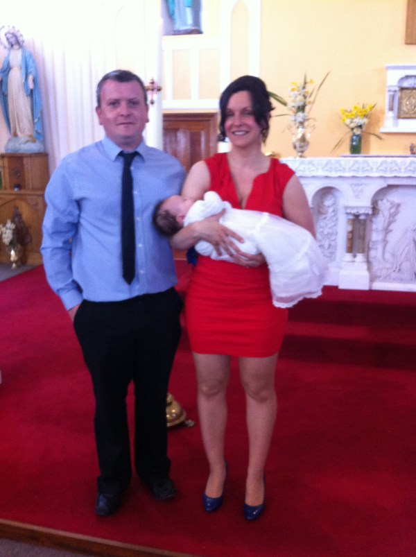 Lydia with her parents Katharine and Kieran on her baptism day.