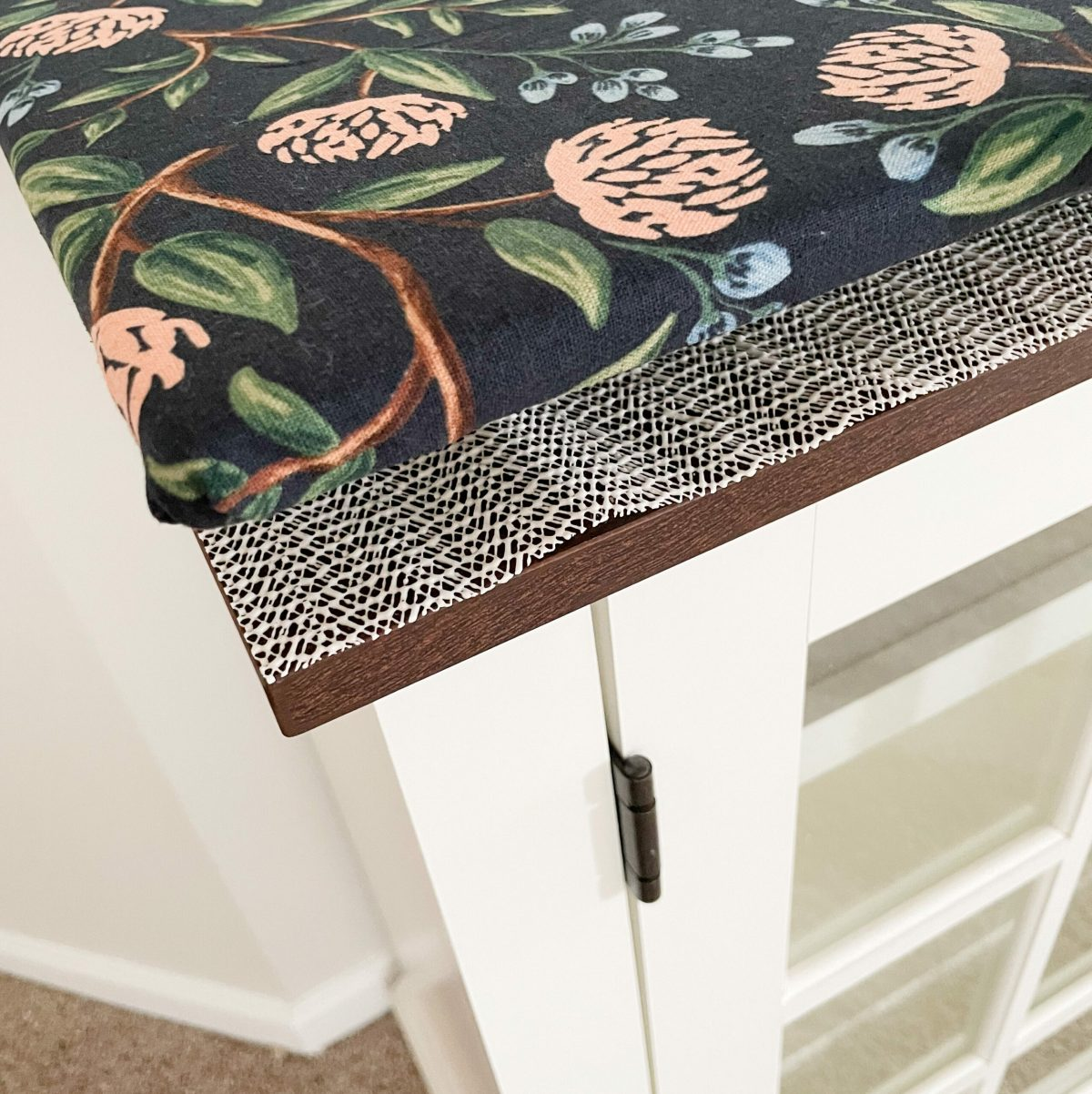 use a nonslip rug pad to keep the board from moving
