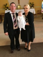 Sophie Ella with her parents on her baptism day.