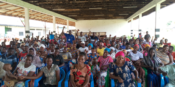 Farmers gathered in the hall of Kilombero Agricultural Training and Research Institute (KATRIN)..