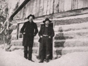 Photo of Daniel Costello, left, and an unknown man outside a logging shanty at a J.R Booth lumber camp. Daniel Costello was born in the township of Hagarty and married Mary Godda of Killaloe. He was bookkeeper for J.R. Booth at McAuley headquarters where he and Mary lived for 14 years until his death. See other related photos in the Logging section. Private Collection.